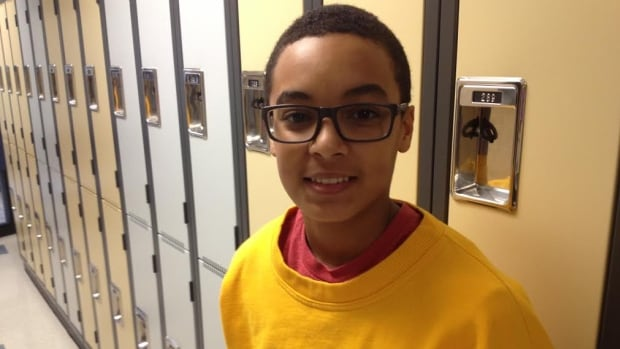 Grade 7 student Essien Udoumoren says he is happy to back at Willow Park. The school reopened Tuesday.