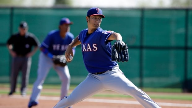 Texas Rangers pitcher Yu Darvish delivers to the plate in an intrasquad game Monday in Surprise, Ariz.