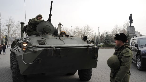 A Russian armoured personnel carrier is driven on a street in Sevastopol, Ukraine's Black Sea Port that hosts a major Russian navy base. Ethnic Russians in the region are deeply suspicious of the new Ukrainian authorities who replaced fugitive Russia-backed President Viktor Yanukovych.