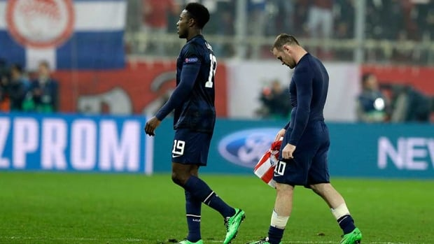 Manchester United's Wayne Rooney, right, and Danny Welbeck leave the pitch after their Champions League match against Olympiakos at Georgios Karaiskakis stadium, in Piraeus port, near Athens, on Tuesday.