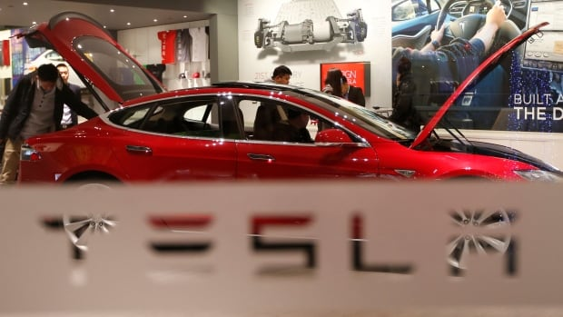 Tesla stocks surged Wednesday after analysts praised the company's future.