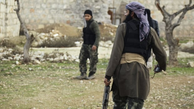 Members of Islamist Syrian rebel group Jabhat al-Nusra, or the Nusra Front, carry their weapons. According to state media, troops killed more than 100 fighters belonging to the al-Qaeda-linked group.