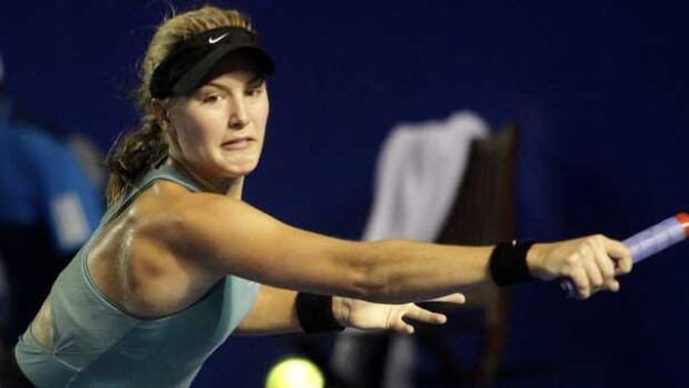 Eugenie Bouchard hits a backhand Tuesday night at the Mexico Open in Acapulco.