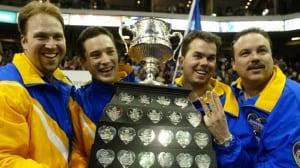 Marcel Roque, Scott Pfeifer, Dave Nehdohin and Randy Ferbey celebrate their third-straight Brier win in Halifax in 2003.