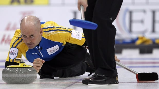 Alberta skip Kevin Koe makes a shot during an evening draw against Ontario at the Tim Hortons Brier in Saskatoon, Sask. Thursday, March, 8, 2012.