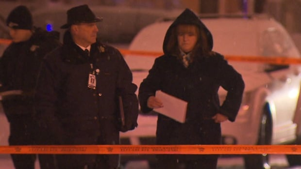 Orange police tape surrounds a Dec. 28 crime scene where a man was stabbed on a St-Michel street corner.