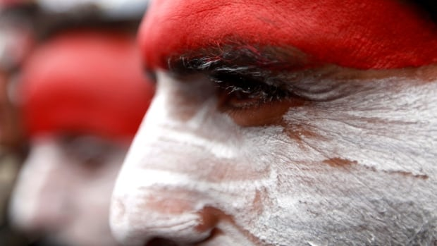 The UN Security Council has issued sanctions against those in Yemen hoping to disrupt the current government, which came to power after the Arab Spring in 2011. Here, pro-democracy demonstrators paint their faces with the colours of the Yemeni flag to mark the anniversary of the Arab Spring uprising.