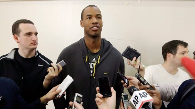 Brooklyn Nets center Jason Collins talks with reporters on Tuesday in Los Angeles as the club continues its road trip.