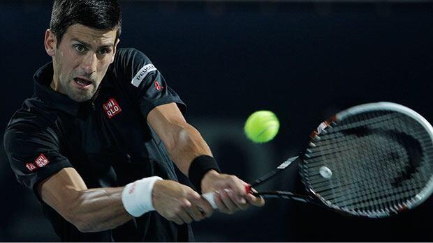 Novak Djokovic of Serbia easily beat Spain's Roberto Bautista-Agut Wednesday in Dubai, United Arab Emirates.