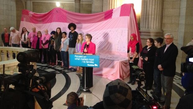 Former Education minister Nancy Allan, other NDP MLAs and Brandon University's Anti-Bullying  Society mark Pink Shirt Day by signing a giant pink blanket bearing the signatures of 7,000 people opposed to bullying in schools.