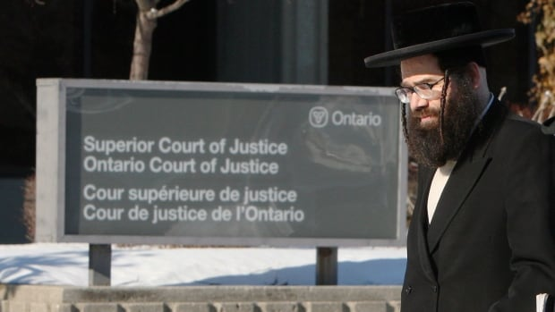 Lev Tahor community spokesman Uriel Goldman walked to the courthouse for the child custody case decision in Chatham, Ont. Monday, Feb. 3, 2014. Nine members of two families fled Chatham in the midst of a custody battle with the courts over more than a dozen children.