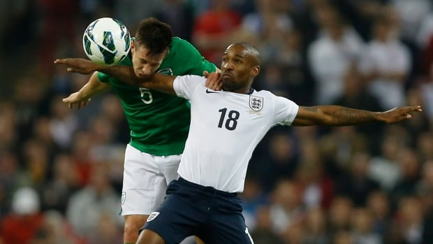 Jermain Defoe, right, seen playing in a 2013 friendly, has made 55 appearances for England.