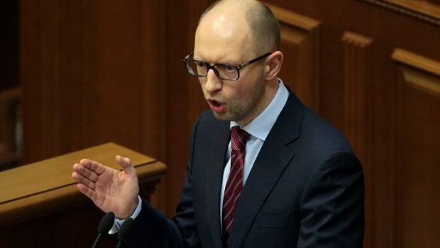 New prime minister Arseniy Yatsenyuk speaks to lawmakers during a session at the Ukrainian parliament in Kyiv on Thursday. He has appealed for help to the IMF and says 37 billion euros are missing from state coffers.