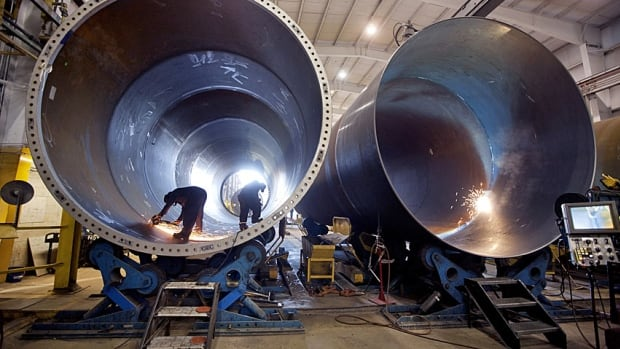 Welders work on wind turbine towers at the DMI Industries Inc. manufacturing plant in Stevensville, Ont. With oil and consumer loans under pressure, banks must lend more to startups and expanding businesses.