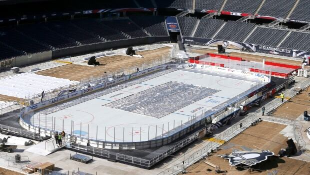Workers continue to transform Soldier Field for Saturday's game between the Chicago Blackhawks and the Pittsburgh Penguins on Thursday.