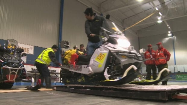 Snowmobilers get ready for the start of Cain's Quest in Labrador City.