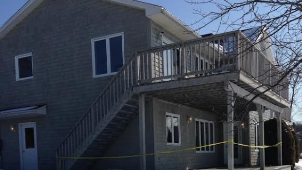 A Rothesay police officer shot a man outside this home Friday evening.