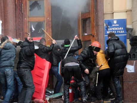 Pro-Russian activists clash with Maidan supporters during an attempted takeover of a regional government building in Kharkiv on March 2. Dozens of protesters were hurt when a pro-Russia protest turned violent, an AFP reporter said.