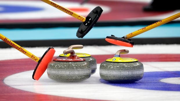 Canada's Kelsey Rocque defeated the United States 8-4 Saturday to move into a tie for top spot in round robin action.