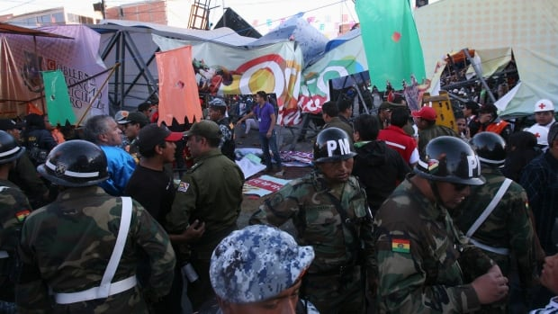 Security personnel surround a footbridge that collapsed during the Carnival parade in Oruro.