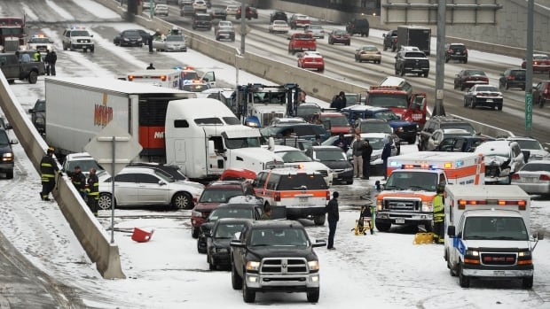 Emergency workers respond to a massive pileup accident on Interstate 25 in Denver on Saturday.