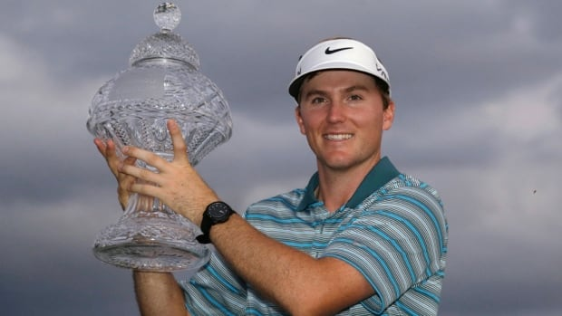 Russell Henley holds up his trophy after winning the Honda Classic on Sunday in Palm Beach Gardens, Fla.