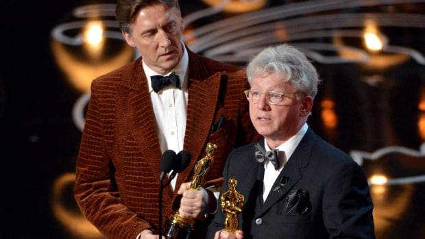 """Nicholas Reed, left, and Malcolm Clarke accept the award for best short subject documentary of the year for """"The Lady in Number 6: Music Saved My Life"""" on stage during the Oscars at the Dolby Theatre on Sunday, March 2, 2014, in Los Angeles."""