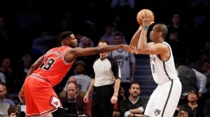 Jason Collins, right, seen in his home debut for Brooklyn on March 3, came out in mid-2013.