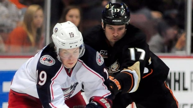 Former Ducks left-winger Dustin Penner, right, scored 13 goals and 32 points in 49 games with Anaheim this season. He was traded to Washington on Tuesday.