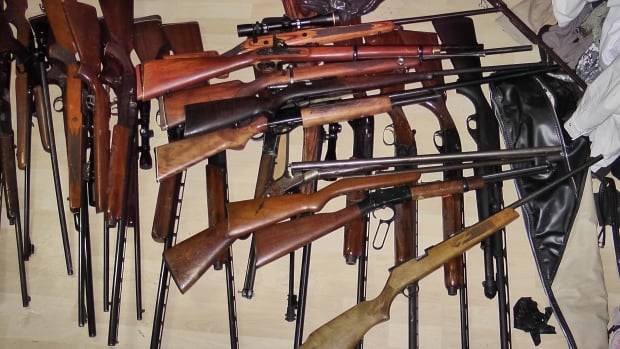Stolen guns were among the items police found in east Calgary residences.