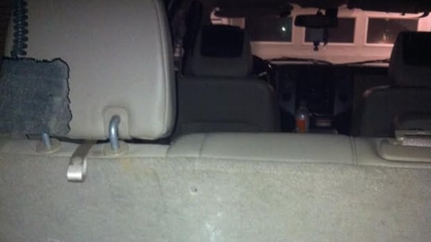 A photo shows where a bullet struck the back seat of an SUV containing seven people, including five children.