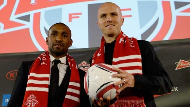 Toronto FC new soccer players Jermain Defoe, left, and Michael Bradley pose during a media conference in January.