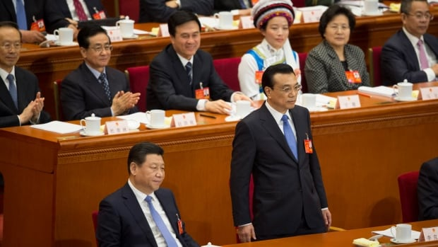 Chinese Premier Li Keqiang, stands next to Chinese President Xi Jinping after speaking at the opening session of the National People's Congress in Beijing's Great Hall of the People on Wednesday. Li promised to open China's economy to more private investment and to reform its banking system.