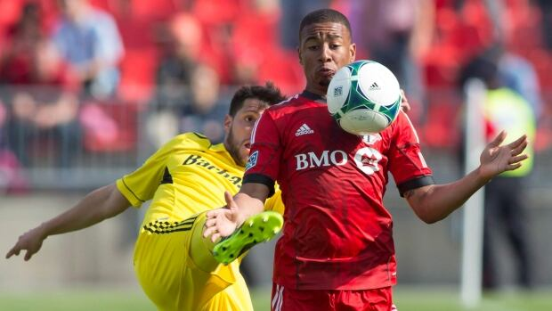Toronto FC midfielder Reggie Lambe, right, has been waived by the club after registering five goals and four assists in 66 appearances since 2011.