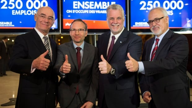 Quebec Liberal leader Philippe Couillard introduces his three economic heavyweights Jacques Daoust, Martin Coiteux and Carlos Leitao, left to right in Montreal.