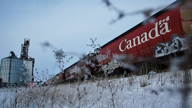 A train car filled with Canadian wheat idles near Winnipeg. Farmers are having difficulty shipping their bumper crops this year.
