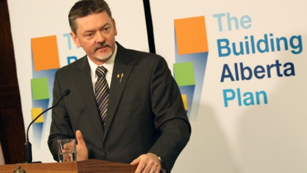 Finance Minister Doug Horner discusses the budget in a pre-speech news conference on Thursday.