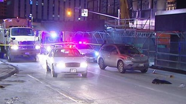 A man in his 20s was struck by and thrown over a vehicle near the Rideau Centre Friday, March 7, 2014.