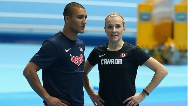 Ashton Eaton, left, of the United States, and Brianne Theisen Eaton of Canada talk during the first day of events at the IAAF World Indoor Championships at Ergo Arena in Sopot, Poland on Friday.