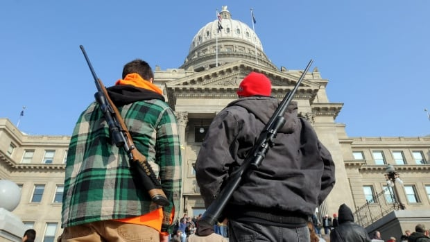 Gun advocates stand outside the Idaho Statehouse after a pro-gun rally on in January 2013. The state's lawmakers passed a bill Thursday allowing concealed guns on college campuses.