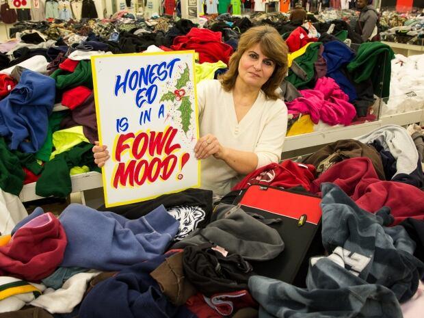 Ausie Hemmati at Honest Ed's sign sale