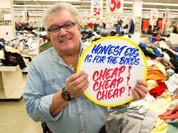 Wayne Reuben at Honest Ed's sign sale