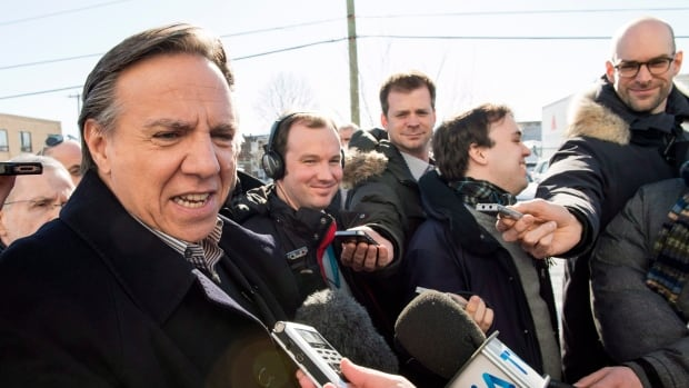 CAQ leader Francois Legault responds to questions during a news conference Friday in Montreal.