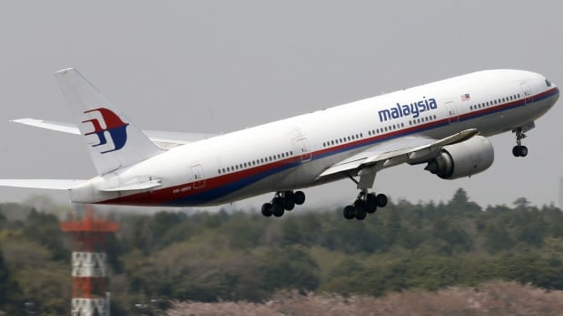 A Malaysia Airlines Boeing 777-200ER at Narita Airport, near Tokyo in March. The airline's stock is to be suspended while it is restructured, a report said.