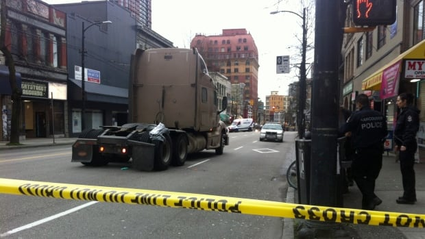 Police have closed West Hastings Street between Richards and Homer to investigate the death of a woman who was hit by this semi truck at around 8 a.m. Saturday morning.