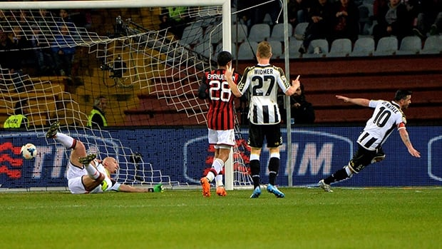 Udinese's Antonio Di Natale, right, celebrates after scoring against AC Milan at the Friuli stadium in Udine on March 8, 2014 .