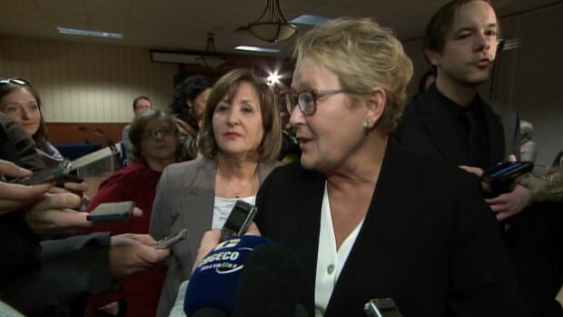 Pauline Marois takes reporters questions after introducing PQ candidate for Bourassa-Sauvé, Leila Mahiout, on the eve of International Women's Day.