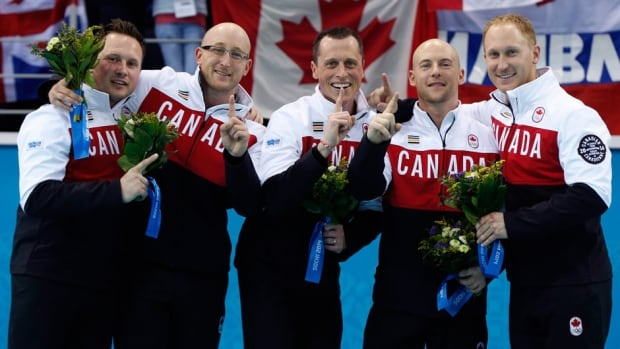 Canada's curlers, from left, Caleb Flaxey, Ryan Harnden, E.J. Harnden, Ryan Fry, and Brad Jacobs won gold at the 2014 Sochi Winter Olympics last month.