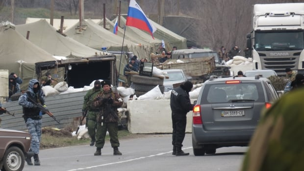 Armed gunmen turned away members of the group representing the Organization for Security and Cooperation in Europe at a checkpoint in Crimea. The group hoped to spend a week looking at military activity in the region.