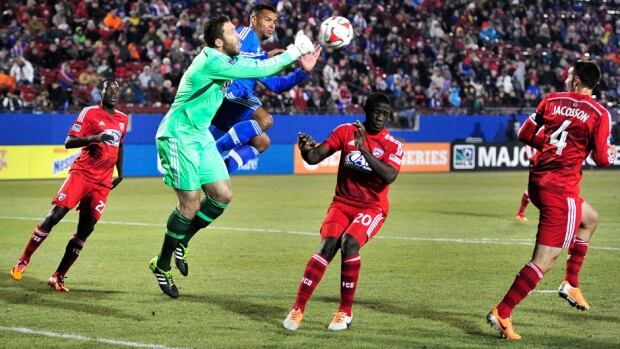 FC Dallas goalkeeper Chris Seitz punches the ball away during FC Dallas' MLS soccer game against the Montreal Impact on Saturday in Frisco, Texas.